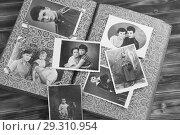 Купить «Старый фотоальбом на деревянном фоне», фото № 29310954, снято 23 октября 2018 г. (c) Марина Володько / Фотобанк Лори