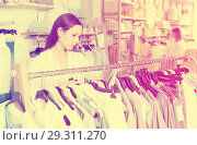 Купить «Woman customer choosing blue blouse in the fashion store», фото № 29311270, снято 15 марта 2018 г. (c) Яков Филимонов / Фотобанк Лори
