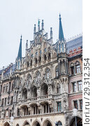 Купить «Fragment of New Town Hall of Munich (Neues Rathaus) neo-Gothic style palace in Marienplatz, the town square in historic center. Germany, Europe», фото № 29312354, снято 27 января 2018 г. (c) Николай Коржов / Фотобанк Лори