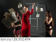 Купить «Group of sexy girls playing erotic perfomance», фото № 29312474, снято 19 июля 2018 г. (c) Гурьянов Андрей / Фотобанк Лори