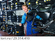 man in coveralls checking motorcycle. Стоковое фото, фотограф Яков Филимонов / Фотобанк Лори