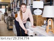 Купить «woman customer touching table with drawers», фото № 29314774, снято 15 ноября 2017 г. (c) Яков Филимонов / Фотобанк Лори