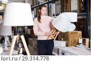 Купить «Female purchaser buying torchere», фото № 29314778, снято 15 ноября 2017 г. (c) Яков Филимонов / Фотобанк Лори
