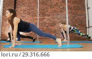 Купить «Young woman training and warming up in a studio. Leg stretching», видеоролик № 29316666, снято 15 октября 2019 г. (c) Константин Шишкин / Фотобанк Лори
