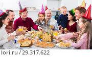 Купить «Glad family members saying toasts during dinner», фото № 29317622, снято 23 января 2019 г. (c) Яков Филимонов / Фотобанк Лори