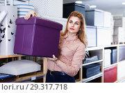 Купить «Young woman choosing soft pouf in modern home furnishings store», фото № 29317718, снято 15 января 2018 г. (c) Яков Филимонов / Фотобанк Лори