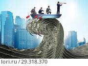 Купить «Businessman leading his team through wave of dollars», фото № 29318370, снято 18 февраля 2019 г. (c) Elnur / Фотобанк Лори