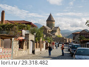 Купить «Tourists on street of old town Mtskheta near Svetitskhoveli Cathedral», фото № 29318482, снято 23 сентября 2018 г. (c) Юлия Бабкина / Фотобанк Лори