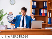 Купить «Young employee working in the office», фото № 29318586, снято 9 августа 2018 г. (c) Elnur / Фотобанк Лори