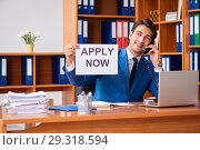 Купить «Young employee working in the office», фото № 29318594, снято 9 августа 2018 г. (c) Elnur / Фотобанк Лори