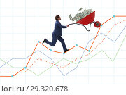 Купить «Businessman pushing wheelbarrow full of dollar money», фото № 29320678, снято 23 апреля 2019 г. (c) Elnur / Фотобанк Лори