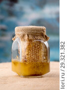 Glass honey jar with bee pollen, honeycombs. Стоковое фото, фотограф Ekaterina Demidova / Фотобанк Лори
