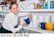 Купить «Woman choosing new crockery in dinnerware store», фото № 29335862, снято 8 февраля 2017 г. (c) Яков Филимонов / Фотобанк Лори