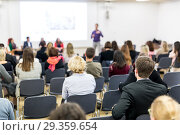 Купить «Audience in lecture hall participating at business conference.», фото № 29359654, снято 16 ноября 2018 г. (c) Matej Kastelic / Фотобанк Лори