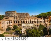 Купить «Top view of the Colosseum and the Arch of Titus, Rome, Italy», фото № 29359954, снято 9 сентября 2017 г. (c) Наталья Волкова / Фотобанк Лори