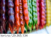 Купить «Город Сочи. Чурчхела на прилавке магазина», эксклюзивное фото № 29365134, снято 3 июня 2018 г. (c) Игорь Низов / Фотобанк Лори
