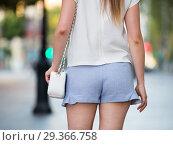 Купить «Female buttocks in blue shorts», фото № 29366758, снято 15 августа 2017 г. (c) Яков Филимонов / Фотобанк Лори