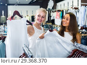 Купить «two women picking new blouse in fashion shop», фото № 29368370, снято 18 декабря 2018 г. (c) Яков Филимонов / Фотобанк Лори