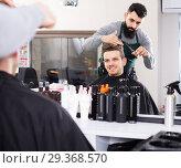 Купить «male hairdresser doing haircut for male client at hair salon», фото № 29368570, снято 27 января 2017 г. (c) Яков Филимонов / Фотобанк Лори