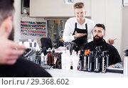 Купить «Hairdresser displaying result of work», фото № 29368602, снято 27 января 2017 г. (c) Яков Филимонов / Фотобанк Лори