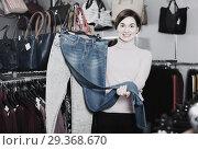 Купить «Woman showing a selection of denim», фото № 29368670, снято 7 февраля 2017 г. (c) Яков Филимонов / Фотобанк Лори