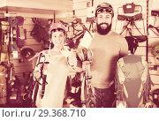 Купить «Couple choosing alpinism equipment in equipment shop», фото № 29368710, снято 24 февраля 2017 г. (c) Яков Филимонов / Фотобанк Лори