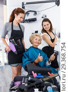 Купить «Hairstylists presenting result of styling to female client», фото № 29368754, снято 26 июня 2018 г. (c) Яков Филимонов / Фотобанк Лори