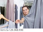 Купить «Woman trying clothes in fitting room», фото № 29368930, снято 10 октября 2018 г. (c) Яков Филимонов / Фотобанк Лори