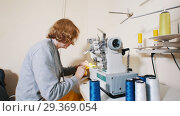 Купить «Mature woman working with sewing machine», видеоролик № 29369054, снято 10 декабря 2018 г. (c) Константин Шишкин / Фотобанк Лори