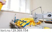 Купить «Mature woman puts a batch of t-shirts next to the sewing machine», видеоролик № 29369154, снято 10 декабря 2018 г. (c) Константин Шишкин / Фотобанк Лори