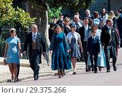 Купить «The wedding of Prince Harry and Meghan Markle at Windsor Castle Featuring: Princess Eugenie, Prince Andrew, Princess Beatrice, Lady Louise Windsor, Commander...», фото № 29375266, снято 19 мая 2018 г. (c) age Fotostock / Фотобанк Лори