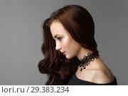 Купить «Pretty woman with long brown hairs on gray background.», фото № 29383234, снято 28 октября 2018 г. (c) Restyler Viacheslav / Фотобанк Лори