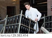 Купить «Male employee transferring bottles of wine to storage», фото № 29383414, снято 10 ноября 2016 г. (c) Яков Филимонов / Фотобанк Лори
