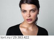 Купить «Portrait of beautiful female model on gray background», фото № 29383422, снято 28 октября 2018 г. (c) Restyler Viacheslav / Фотобанк Лори