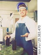 Купить «worker using machine at wine factory», фото № 29383470, снято 10 ноября 2016 г. (c) Яков Филимонов / Фотобанк Лори