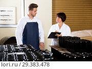 Купить «Employees checking number of wine bottles», фото № 29383478, снято 10 ноября 2016 г. (c) Яков Филимонов / Фотобанк Лори