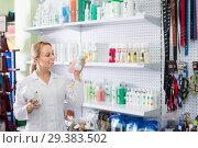Купить «Smiling woman seller advising on pet shampoo», фото № 29383502, снято 15 ноября 2018 г. (c) Яков Филимонов / Фотобанк Лори