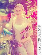 Купить «young female gardener caring roses», фото № 29383518, снято 17 ноября 2019 г. (c) Яков Филимонов / Фотобанк Лори