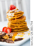 Купить «Pancakes served with fruit, honey, chocolate and whipped cream», фото № 29383714, снято 21 ноября 2018 г. (c) Яков Филимонов / Фотобанк Лори