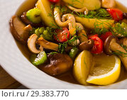 Купить «Mushroom broth prepared with boiled honey fungus and vegetables», фото № 29383770, снято 19 марта 2019 г. (c) Яков Филимонов / Фотобанк Лори