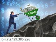 Купить «Businessman pushing wheelbarrow uphill in debt loan concept», фото № 29385226, снято 22 ноября 2018 г. (c) Elnur / Фотобанк Лори