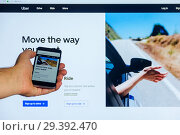 Купить «Moscow, Russia - October 16, 2018: The home Internet page of the mobile application Uber.com on the screen the smart phone in male hand on a against the background computer monitor», фото № 29392470, снято 16 октября 2018 г. (c) Андрей С / Фотобанк Лори