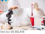 Купить «Young handsome lab assistant testing blood samples in hospital», фото № 29392818, снято 31 августа 2018 г. (c) Elnur / Фотобанк Лори