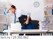 Купить «Overloaded busy employee with too much work and paperwork», фото № 29392862, снято 3 июля 2018 г. (c) Elnur / Фотобанк Лори