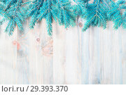 Купить «New Year and Christmas background. Blue fir tree branches on the wooden background. New Year and Christmas festive still life, space for text», фото № 29393370, снято 8 мая 2017 г. (c) Зезелина Марина / Фотобанк Лори