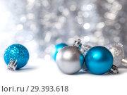 Купить «Christmas decorations with bokeh background», фото № 29393618, снято 6 ноября 2018 г. (c) Юлия Бабкина / Фотобанк Лори