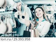 Купить «Female customer deciding on pretty bra», фото № 29393958, снято 20 марта 2017 г. (c) Яков Филимонов / Фотобанк Лори