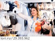 Купить «Female customer deciding on pretty bra», фото № 29393962, снято 20 марта 2017 г. (c) Яков Филимонов / Фотобанк Лори