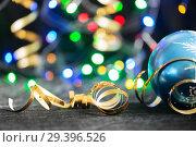 Купить «Party Background with Christmas toy, lights and serpentine», фото № 29396526, снято 17 декабря 2018 г. (c) Владимир Пойлов / Фотобанк Лори
