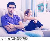 Купить «Man on sofa after quarrel with wife», фото № 29396786, снято 23 мая 2019 г. (c) Яков Филимонов / Фотобанк Лори